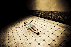 Crucified woman. Young seminude crucified woman on the floor Stock Images