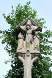 Crucifijo de piedra tallado Imagenes de archivo