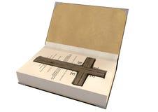 Crucifijo encubierto en una biblia Fotografía de archivo