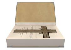 Crucifijo encubierto en una biblia foto de archivo libre de regalías