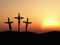 Crucifissione e tramonto rosso Fotografie Stock Libere da Diritti