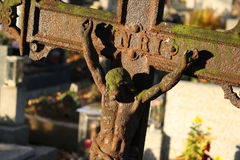 Crucifix. A cross with the Jesus body covered by rust stock photo
