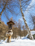 Crucifix in the alps Stock Images