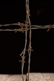 Crucifix from barbed wire Stock Photo