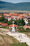Crucifix on Benedek Hill, Veszprem, Hungary. Couple in love is walking to the crucifix on Benedek Hill, Veszprem, Hungary royalty free stock image