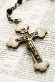 Crucifix on Bible. Stock Photo