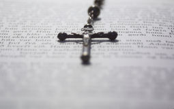 Crucifix on a book Stock Images