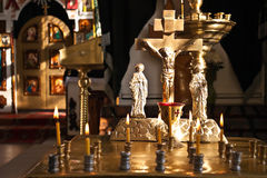 Crucifix and burning candles. Crucifix and burning candles in an Orthodox church Stock Images