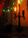 Crucifix and candles in the dark Royalty Free Stock Photo