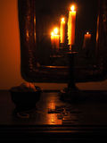Crucifix and candles in the dark stock photos