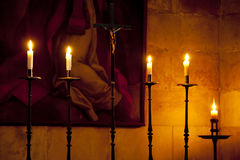 Crucifix and candles Royalty Free Stock Photo