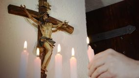 Crucifix and candles stock video