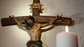 Crucifix and candles stock footage