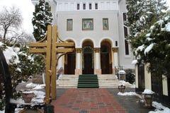 Crucifix and church Biserica Buna Vestire, Brasov Stock Image