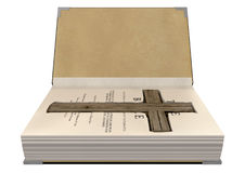 Crucifix Concealed In A Bible. An open hardback bible with a cutaway area in the pages concealing a wooden crucifix on an isolated background Royalty Free Stock Photo