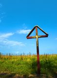 Crucifix in countryside Stock Photo