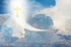 Crucifix or cross on heaven cloudy sky with lens flare. Crucifix or cross on heaven cloudy heavenly sky with lens flare Stock Photography