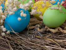 Crucifix and Easter eggs Stock Photography