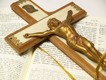 Crucifix and Greek New Testament Stock Images