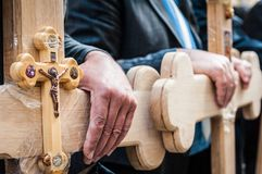 Crucifix and Hands Royalty Free Stock Photography