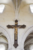 Crucifix hanging on the wall. In an old abbey in the Meuse in France Stock Image
