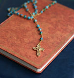 Crucifix on Holy Bible Stock Photo