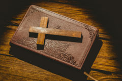 Crucifix icon on the bible Stock Photography