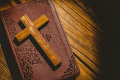 Crucifix icon on the bible Royalty Free Stock Photos