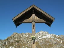 Cross on mountain. Crucifix characteristic of the Italian Alps Stock Photo