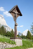 Crucifix in the mountains at cortina d'ampezzo Royalty Free Stock Photos