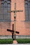 Crucifix near the brick wall Stock Photos