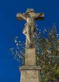 Crucifix near church in Krasna Lipa town stock images