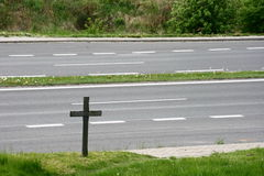 Crucifix near the road. A photo of a crucifix near the road Royalty Free Stock Images