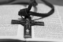 Crucifix necklace on a bible page Stock Photography
