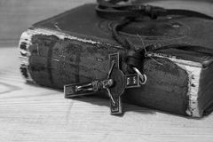 Crucifix necklace on a bible with wood background Stock Photo