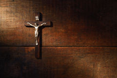 Crucifix On Wooded Wall Stock Photos