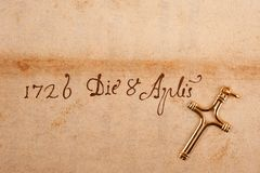 Crucifix on parchment. Crucifix on old parchment with written Stock Photography