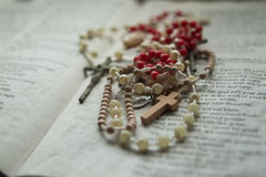 Crucifix and Rosary 2. A solemn picture of a crucifix and rosaries resting on a bible Stock Image