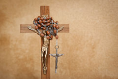 Crucifix and rosary. Crucifix figurine and rosary beads Stock Photography