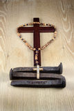 Crucifix, Rosary and Three Spikes Stock Photo