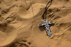 Crucifix in the sand Stock Image