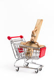 Crucifix in shopping cart Stock Images