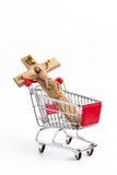 Crucifix in shopping cart Stock Photos