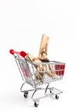 Crucifix in shopping cart Stock Photo