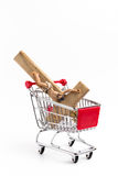 Crucifix in shopping cart Royalty Free Stock Images