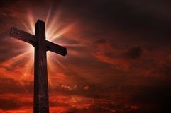 Crucifix in Sunset. Bright Light Above the Crucifix / Cross. Dark Red Cloudy Sky. Christian Theme vector illustration