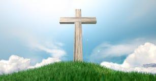 Crucifix sur une colline herbeuse et un ciel bleu Image stock