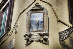 Crucifix tabernacle on a wall Stock Photos