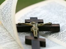 Crucifix on Top of Bible Stock Image