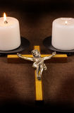 Crucifix and Two Candles Stock Images